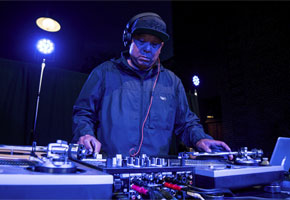 """DJ Babu on the decks at the opening reception for """"Don"""